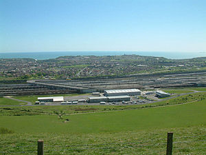 Channel Tunnel - The British terminal at Cheriton in west Folkestone. The terminal services shuttle trains that carry vehicles, and is linked to the M20 motorway