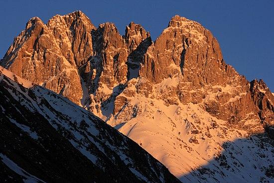 Chaukhi Massif known as Dolomites of Georgia ta sunset near or part of Kazbeki National Park.jpg