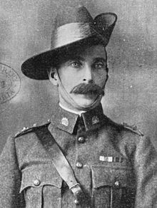 Head and shoulders view of man with large moustache in uniform, with Sam Brown belt, rising sun badges on his collars, and a slouch hat, turned up on the left side. He wears two ribbons on the left breast.