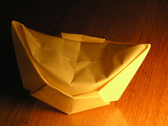 Chinese paper folding - Paper folded into the shape of a sycee, a Chinese gold ingot