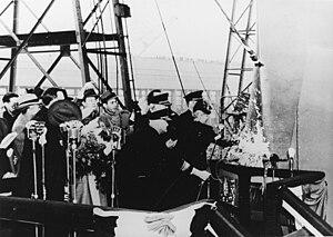 USS Shangri-La (CV-38) - Mrs. James H. Doolittle christens Shangri-La at the Norfolk Navy Yard, Virginia, 24 February 1944.