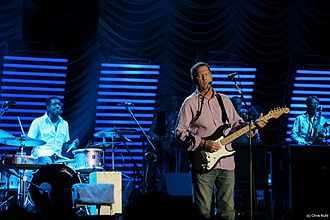 Steve Jordan (musician) - Steve Jordan, left, with drum kit, performing with Eric Clapton's set during  The Crossroads Guitar Festival in 2007