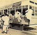 Commuters entering a Calcutta tram through its windows (1945).jpg