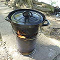 Cooking potatos on a large hobo stove 05.jpg
