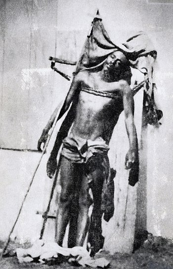 The body of caco leader Charlemagne Peralte on display after his execution by US forces; the image had the opposite effect, with the resemblance to a crucifixion gaining Peralte the status of national martyr Corps de Charlemagne Peralte.jpg