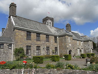 Manor of North Molton - Court House, North Molton, built in 1553 by the Parker family; viewed from SW. The church tower is visible behind