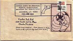 Mail art - Mail art stamp and envelope with official Colt Anniversary postmark – Chuck Welch, aka Cracker Jack Kid, 1984