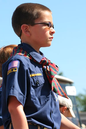 A Cub Scout stands at attention. Independence ...