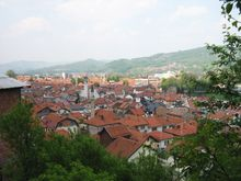 View from beneath hill Visočica. It encompasses both old (near) and new districts (far) of town