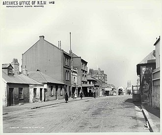 Long's Lane Precinct - 136-138 Cumberland Street, the three-storey terrace at left with an awning, pictured in 1901.
