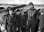 Curious-children-gather-around-female-pilot-who-emergency-landed-at-Gardet-142348236993.jpg