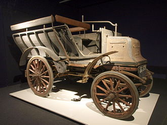 Automotive industry in the United Kingdom - Daimler shooting brake 6 hp, twin-cylinder, 1526 cc engine, mounted at the front of the car, four-speed gearbox and chain drive manufactured Coventry 1897 in the UK's first series production run  Louwman Museum