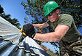 Defense.gov News Photo 110131-N-2984R-220 - U.S. Marine Corps Lance Cpl. Stephen S. Mcdonaldhale assigned to the 2nd Marine Logistics Group repairs the roof of a classroom at Escuela Santa.jpg