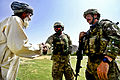 Defense.gov News Photo 110719-F-FT240-050 - U.S. Army 1st Lt. Benjamin Riley right and a Provincial Reconstruction Team Zabul interpreter center meet a villager during a patrol to the.jpg