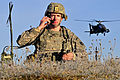 Defense.gov News Photo 111115-A-SR857-002 - U.S. Army Cpt. Troy Peterson directs an AH-64 Apache attack helicopter strike on a target at the Close Combat Attack lane during the U.S. Army.jpg