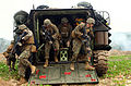 Defense.gov News Photo 120210-M-VX252-083 - Marines with Company B Battalion Landing Team 1st Battalion 4th Marines 31st Marine Expeditionary Unit exit an amphibious assault vehicle and.jpg