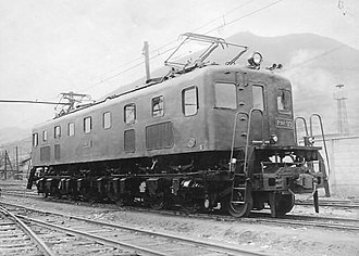 Builder's photo - 1946 builder's photo of a DeRoI-33 electric locomotive built by Mitsubishi. The photograph's background shows a reduced contrast to place more emphasis on the locomotive.
