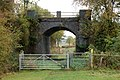 Disused railway bridge by Wolhampcote church (1) - geograph.org.uk - 1544982.jpg