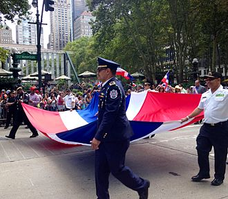 Dominican Day Parade in New York City, 2014 Dominican people at Dominican parade, New York City.jpg