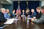 President Donald J. Trump, joined by Texas Gov. Gregg Abbott, Lt. Gov. Dan Patrick and FEMA officials, attends a briefing on the continuing Hurricane Harvey relief and recovery efforts, during a meeting in the Signature Flight Support facility at Dallas Love Field, Wednesday, October 25, 2017, in Dallas, Texas. Gov. Abbott thanked President Trump for his commitment to Texas.