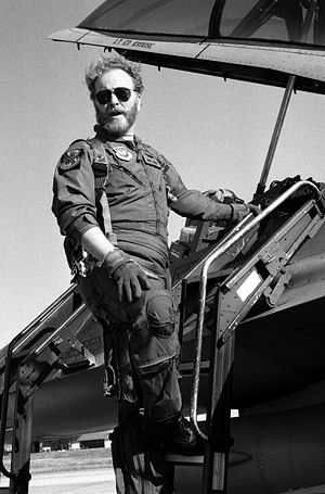 Bob Dornan - Dornan standing on the ladder of an F-16 Fighting Falcon aircraft during a visit to Torrejon Air Base, Spain, 20 September 1988.