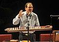 Dr.Oke presenting his calibrated Shruti-Veena at NCPA, Mumbai.jpg