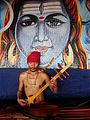 Dranyen player in India - lups and his dranyen.jpg
