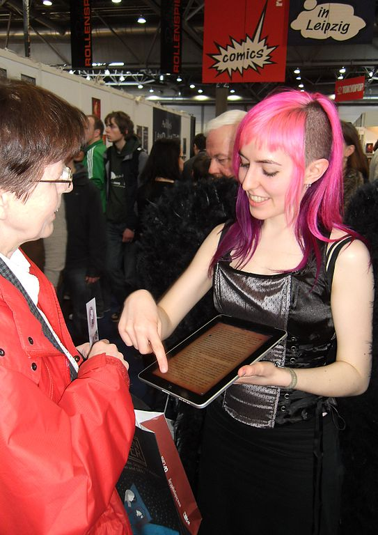 Young person demonstrating e-reader