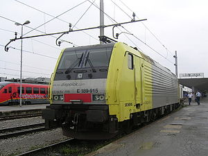 Dispolok - Siemens locomotive of type ES 64 F4 in yellow and silvery Dispolok livery