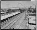 East view - general left to right; Platform, trackage, canopies, and roof of Station Building at right - North Philadelphia Station.tif