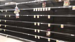 Empty bread shelves (49665889091).jpg