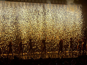 """The Mrs. Carter Show World Tour - Beyoncé performing """"End of Time"""" with the French dancing duo Les Twins and her female background dancers as pyrotechnics fell on stage."""