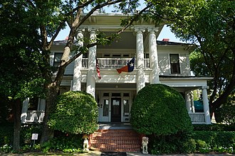 Ennis, Texas - The Raphael House is one of several dozen registered historic homes in Ennis. It was built in 1905 in the Neoclassical Revival style.