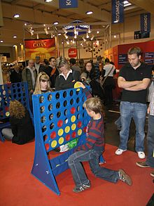 Children playing giant Connect Four.