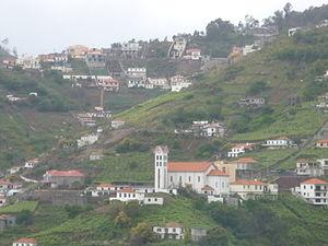 Estreito de Câmara de Lobos - The settlement of Garachico, with the Church of Nossa Senhora do Bom Sucesso in the foreground, as seen in the Ribeira da Caixa from the centre of Estreito