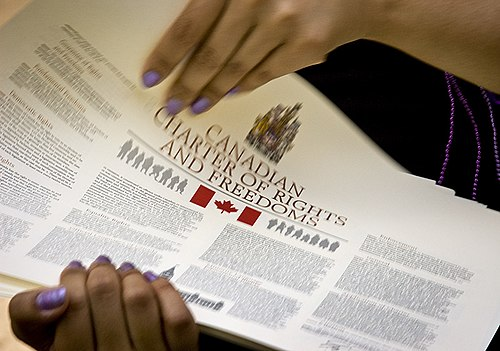Printed copies of the Canadian Charter of Rights and Freedoms Every Canadian Needs A Copy.jpg