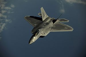 An F-22 Raptor flies over Kadena Air Base, Japan