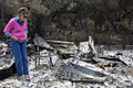 FEMA - 33540 - Resident looks through the ashes of her burned cottage in California.jpg