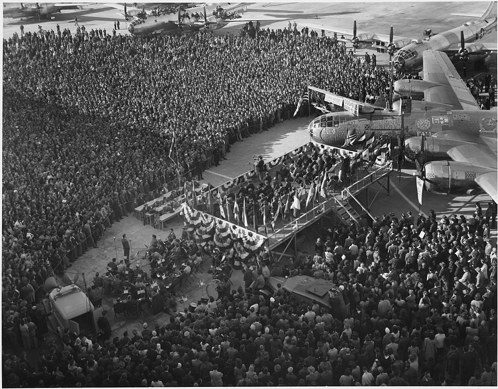 Favored by Warm breezes and under a blue Kansas Sky, a vast crowd attends the delivery ceremony on the Boeing-Wichita... - NARA - 196890