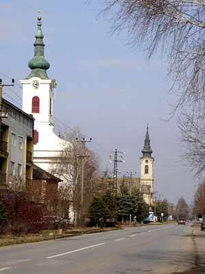 Feketić - Main street with Calvinist and the abandoned Lutheran Church