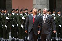 Mexican president Felipe Calderón (left) and B...