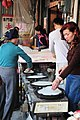 Female street vendor makes a spring roll wrapper in Jincheng.jpg
