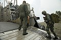 Filipinos get a ride in Marine amphibious landing craft 151002-M-OC926-093.jpg