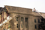 Firefighters use an extended truck ladder to reach the roof of the Pentagon Building to conduct rescue operation after the September 11, 2001 attacks 010911-N-AV833-078.jpg