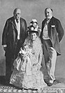 Olga FitzGeorge (center) with her grandfather, father, and son.