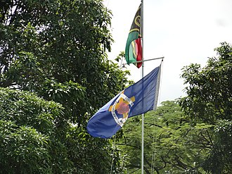 Presbyterian Church of Vanuatu - Flagpole at the Talua Ministry Training Centre with the flags of Vanuatu (top) and the Presbyterian Church in Vanuatu.
