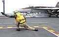 Flickr - Official U.S. Navy Imagery - A Sailor directs a jet to launch from the flight deck..jpg