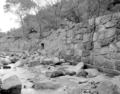 Flood damage to rock wall on Virgin River, a quarter mile south of Court of Patriarchs. Record of damage or defective (c5c6c34ee6304824b42ab2186c3f71c6).tif