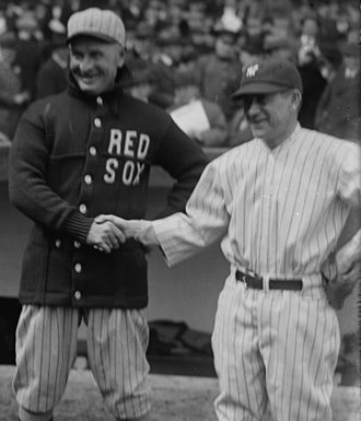 Frank Chance - Chance (left) shakes hands with Miller Huggins in 1923