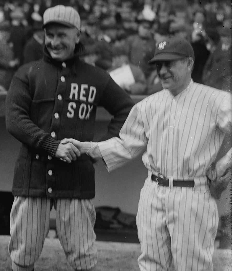 Frank Chance and Miller Huggins shake hands CROP